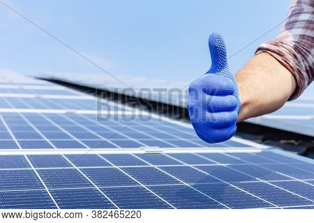 Male Worker Showing Thumbs Up, Positive Gesture Against Solar Panel, Solar Station. Like To Alternat