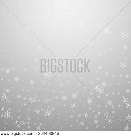Sparse Glowing Snow Christmas Background. Subtle Flying Snow Flakes And Stars On Light Grey Backgrou