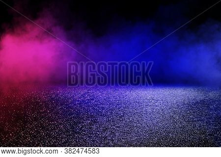Abstract Image Of Empty Wet Asphalt Road With Neon Light Reflection And Smoke In Background. (select