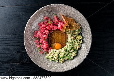 Tuna Tartare Guacamole Quail Egg On A Plate. Delicious Healthy Raw Food Closeup Served For Lunch On