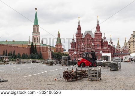 Moscow, Russia - August 24, 2020: Red Square, Historical Museum. A Black And Red Forklift Transports