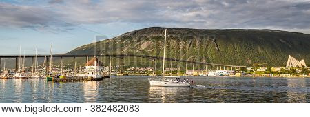 Skyline With The Harbor, Bridge And Arctic Cathedral Of Tromso In Northerm Norway