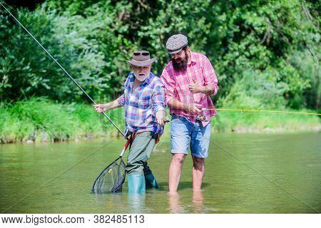 Hobby And Sport Activity. Trout Bait. Male Friendship. Family Bonding. Summer Weekend. Mature Men Fi