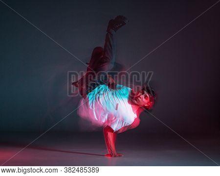 Cool Young Guy Breakdancer Dancing Hip-hop On The Floor In Neon Light. Dance School Poster. Long Exp
