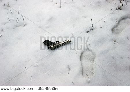 The Intruder Threw A Gun In A Snowy Forest, In The Hope That They Would Not Be Found. Murder Weapon.