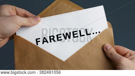 Male Hands Holding Craft Envelope With Text Farewell On Blue Background, Concept