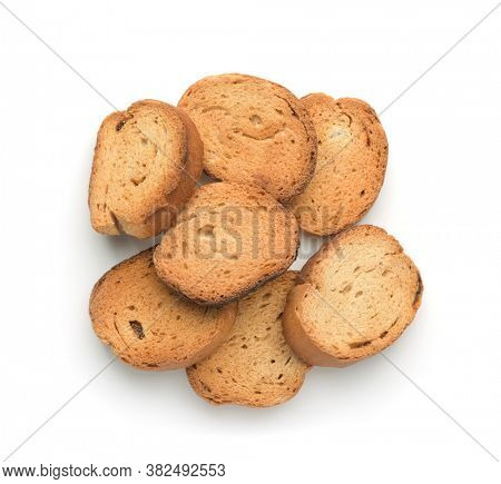 Top view of wheat baked rusks isolated on white