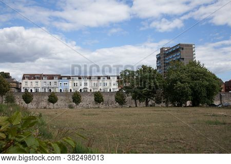 A View Of The Town Wall And Surrounded Residential Properties At West Quay In Southampton In The Uk,