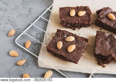 Chocolate Brownie Cake Cut In Small Square Pieces And Served With Almonds. Homemade Dessert Recipe