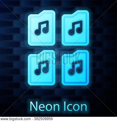Glowing Neon Music File Document Icon Isolated On Brick Wall Background. Waveform Audio File Format