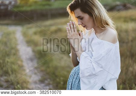 Pregnant Woman Praying Outdoors On At Sunset. Concept For Faith, Spirituality And Religion. Peace, H