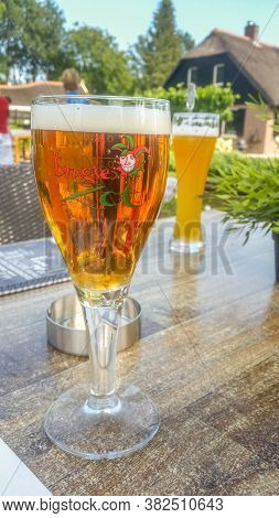 Giethoorn, Netherlands - 23 August, 2017: Fresh Belgium Beer Named Brugse Zot Served On A Glass. The