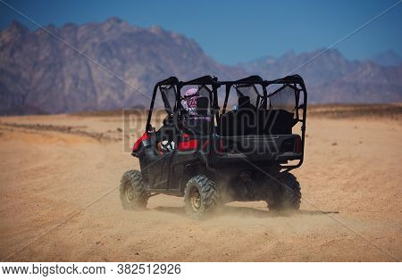 Excited People Driving Away For Buggy Safari Tour Through The Mountain Desert