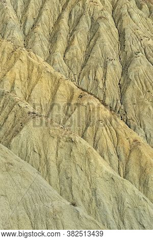 Full Screen View Of The Water Eroded Slope Of A Desert Arid Ravine
