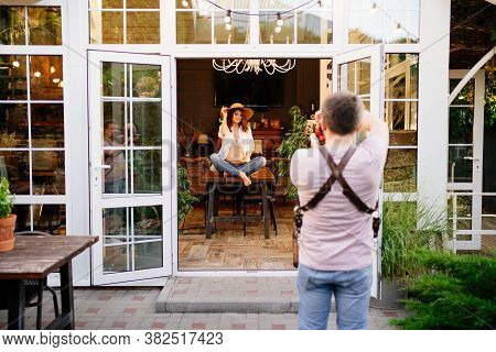 A Professional Photographer Takes A Picture Of The Woman In The Hat Expecting A Baby In A Country Ho