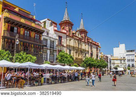 Sevilla, Spain - May 14, 2019: Cafe And La Paz Church At The Plaza Del Salvador In Sevilla, Spain