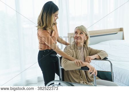 Happy Mix Skin Family. Senior Woman And Young Daughter Smile Happily.  Grow Granddaughter Take Care