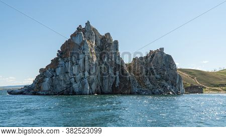 Shamanka Rock On Olkhon. Cape Burhan. Rock Near The Shore, View From The Water.