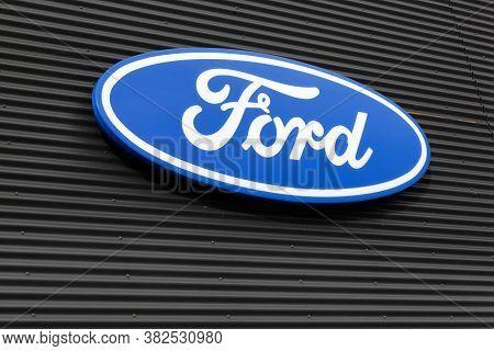 Skanderborg, Denmark - October 21, 2017: Ford Logo On A Building Wall. Ford Is An American Multinati