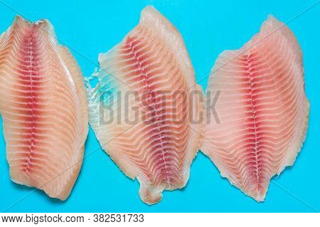 Whitefish Tilapia Fish Raw Fillet. Selective Focus. To Close. Top View, Contains Omega 6 And Omega 3