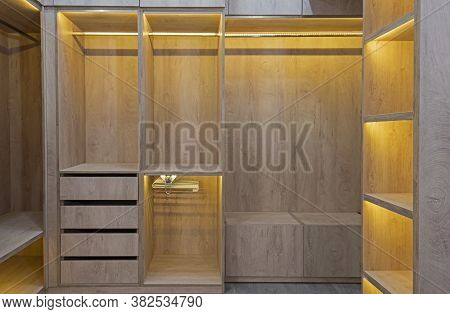Interior Design Decor Furnishing Of Luxury Show Home Bedroom Showing Walk In Wooden Wardrobe Closet