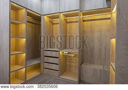 Interior Design Decor Furnishing Of Luxury Show Home Bedroom Showing Walk In Wooden Wardrobe Closet