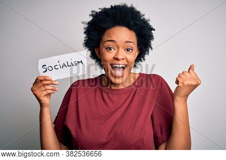 Young African American afro politician woman with curly hair socialist party member screaming proud and celebrating victory and success very excited, cheering emotion