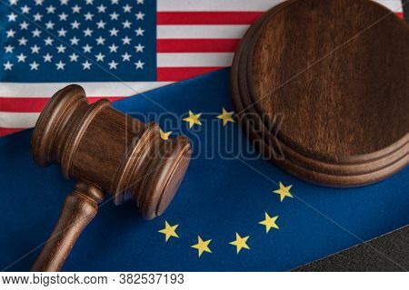 Judge Gavel Over Us Flag And Eu. Trade War. Legal Confrontation United States Of America And Europea