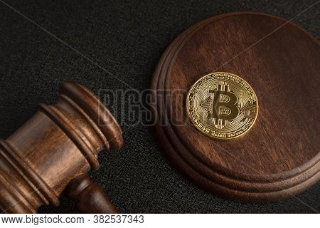 Bitcoin And Judge Gavel. Cryptocurrency Legislation. Close Up. Violation Of Law.