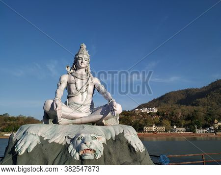 Lord Shiva Staute On The Banks Of River Ganga, Hindu God In Rishikesh