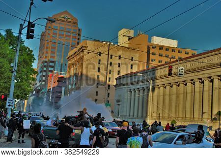 Dayton, Ohio United States 05/30/2020 Police Officers Deploying Pepper Spray And Tear Gas Over The C