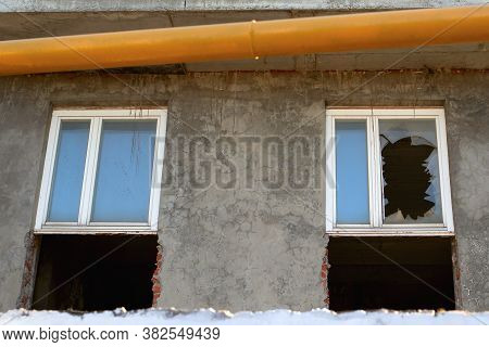 Broken Window In A Destroyed Building. Concept Of The Consequences Of Vandal Actions Of Criminals In