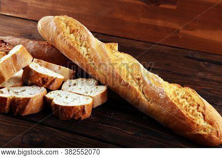 Baguette Baked Bread And Sliced Baguette On Background