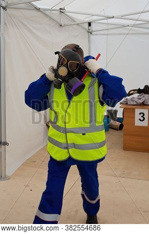 Worker Puts On Gas Mask To Protect Against Gas In Emergency