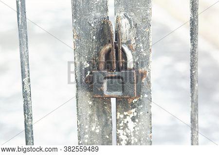 Old Master Key Locked On Iron Gate, Steel Padlock, Close Up Selective Focus, Soft Background Blur