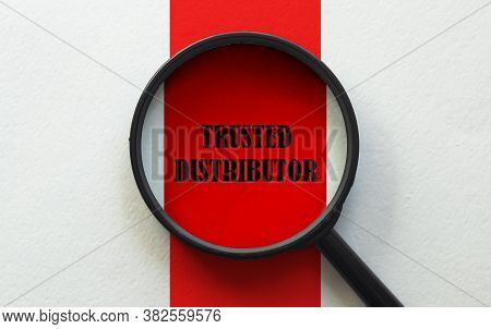 Magnifier With Text Trusted Distributor On The White And Red Background