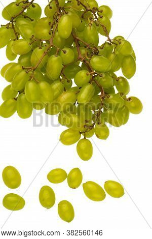 A Bunch Of Table Grapes On A White Background And A Bunch Of White Grapes Scattered, On A White Back