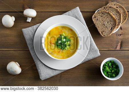 Champignon Soup In White Bowl On Napkin. Whole Champignons, Bread Flat Lay With Place For Text On Wo