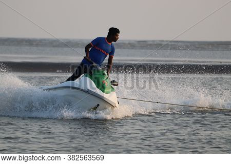 Panaji, Goa/india- November 18 2019:  A Young Man Riding A Jet Ski On The Sea. Adventure And Water S