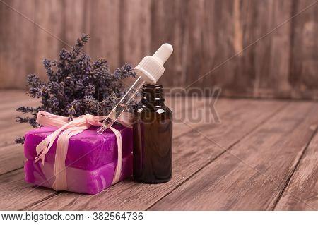 Dropper Bottle With Lavender Essential Oil, Natural Soap With Lavender Extract And Lavender Flowers