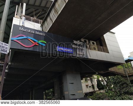 Mumbai, Maharastra/india- October 28 2019: Reliance Mumbai Metro Rail Sign Board Under A Bridge. It