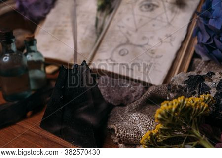 Open Old Book With Magic Spells, Runes, Black Candle