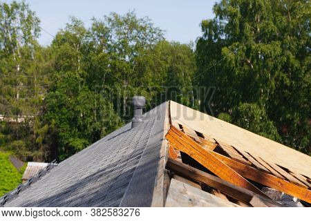 old roof renovation, frame of the roof covered with wooden OSB boards