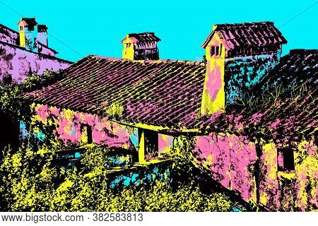 Chimneys Over Rooftop Of A Worn Old House With Worn Wall At Marvao. A Medieval Fortified Village On