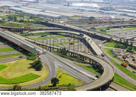 Aerial View Of Empty Highway Interchange With Disappearing Traffic On A Bridge And Streets Roads And