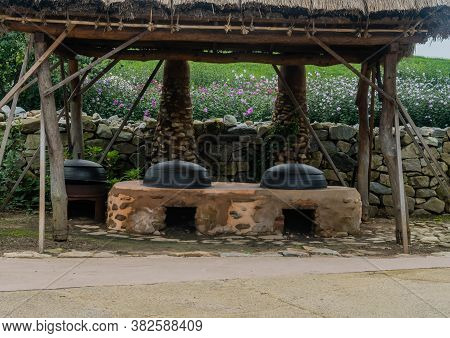 Seosan, South Korea; August 14, 2020: For Editorial Use Only.old Fashioned Cooking Cauldrons Set In