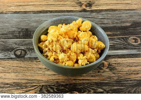 Hot Spicy Barbecue Popcorn Snack In Ceramic Bowl On Table