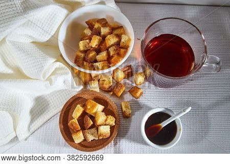 Square Toasted Pieces Of Homemade Delicious Rusk, Hardtack, Dryasdust, Zwieback, Liquid Honey In A S