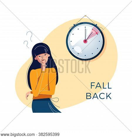 Daylight Saving Time. Confused Woman Is Looking At The Clock. Winter Time Concept. Text Fall Back. T