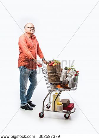 Indian Asian Senior Man With Shopping Trolly Or Cart